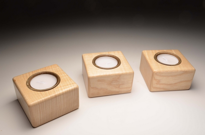 A set of three tealight holders in Ash