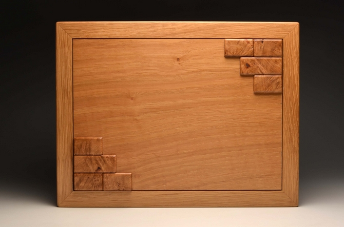 A solid oak display case for four watches No.0208